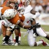 Oklahoma\'s Tony Jefferson (1) brings down Texas\' Malcolm Brown (28) during the Red River Rivalry college football game between the University of Oklahoma Sooners (OU) and the University of Texas Longhorns (UT) at the Cotton Bowl in Dallas, Saturday, Oct. 8, 2011. Photo by Bryan Terry, The Oklahoman