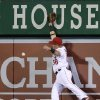 Photo - Los Angeles Angels right fielder Kole Calhoun can't catch an RBI double by Seattle Mariners' Dustin Ackley during the sixth inning of a baseball game Tuesday, April 1, 2014, in Anaheim, Calif. (AP Photo/Jae C. Hong)