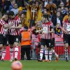 Photo - Sheffield United's Jose Baxter, left, celebrates his goal against Hull City with teammates during their English FA Cup semifinal soccer match at Wembley Stadium in London, Sunday, April 13, 2014. (AP Photo/Sang Tan)