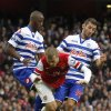 Photo -   Arsenal's Jack Wilshere, center, is tackled by Queens Park Rangers' Stephane Mbia, left, and Esteban Granero during their English Premier League soccer match at Emirates stadium, London, Saturday, Oct. 27, 2012. (AP Photo/Sang Tan)