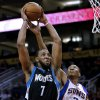 Minnesota Timberwolves\' Derrick Williams (7) dunks over Phoenix Suns\' Wesley Johnson (2) during the first half of an NBA basketball game, Tuesday, Feb. 26, 2013, in Phoenix. (AP Photo/Matt York)