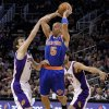 New York Knicks guard Jason Kidd (5) passes over Phoenix Suns\' Goran Dragic, of Slovenia, (1), and Luis Scola, of Argentina, during the first half of an NBA basketball game on Wednesday, Dec. 26, 2012, in Phoenix. (AP Photo/Matt York)