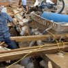 Tom Green tries to recover items from his daughter\'s house that was destroyed by Tuesday\'s tornado west of El Reno, Wednesday, May 25, 2011. Photo by Chris Landsberger, The Oklahoman