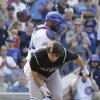 Photo - Colorado Rockies' Charlie Culberson, front, throws his helmet after being called out on strikes during the ninth inning of a baseball game against the Chicago Cubs in Chicago, Thursday, July 31, 2014. The Cubs won 3-1. (AP Photo/Nam Y. Huh)