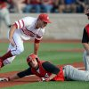 Photo - Indiana's Dustin DeMuth, left, tries to make the tag on Youngstown State's Josh White at third base during an NCAA college egional baseball game in Bloomington, Ind. Friday, May 30, 2014. (AP Photo/The Herald-Times, Chris Howell)