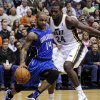 Photo - Orlando Magic point guard Jameer Nelson (14) drives to the basket as Utah Jazz power forward Paul Millsap (24) defends in the second quarter of an NBA basketball game, Wednesday, Dec. 5, 2012, in Salt Lake City. (AP Photo/Rick Bowmer)
