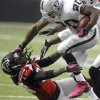 Photo -   Oakland Raiders Darren McFadden (20) stiff-arms Atlanta Falcons cornerback Dunta Robinson (23) to the ground during the second half of an NFL football game, Sunday, Oct. 14, 2012, in Atlanta. (AP Photo/John Bazemore)