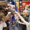 Rumble, Oklahoma City Thunder mascot, visits patients during an in-house carnival at the J.D. McCarty Center in Norman. Photo by Steve Sisney, The Oklahoman