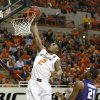 Oklahoma State guard Le\'Bryan Nash (2) goes up for a dunk in front of Kansas State forward Jordan Henriquez (21) in the first half of an NCAA college basketball game in Stillwater, Okla., Saturday, March 9, 2013. Oklahoma State won 76-70. (AP Photo/Sue Ogrocki)