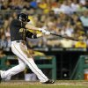 Photo - Pittsburgh Pirates' Neil Walker hits a two-run home run during the fifth inning of a baseball game against the Milwaukee Brewers on Tuesday, Aug. 27, 2013, in Pittsburgh. (AP Photo/Keith Srakocic)