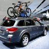 Bicycles are shown as accessories on the Suburu Outback wagon at the North American International Auto Show in Detroit, Wednesday, Jan. 16, 2013. Transportation of the two-wheeled variety is sharing the floor at the auto show in Detroit along with the latest cars, trucks and concept vehicles. Bikes weren\'t the focus of presentations during this week\'s press previews, but they\'re often used in marketing cars. (AP Photo/Paul Sancya)