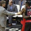 Toronto Raptors forward Amir Johnson (15) is restrained as his is ejected during an NBA basketball game against the Portland Trail Blazers on Monday, Dec. 10, 2012, in Portland, Ore. (AP Photo/The Oregonian, Bruce Ely)