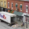 FILE - In this Wednesday, May 23, 2012, file photo, A Federal Express truck makes a delivery in downtown Chagrin Falls, Ohio. FedEx said Tuesday, Dec. 4, 2012, that it will be offering some employees up to two years\' pay to leave the company starting next year. The voluntary program is part of an effort by the world\'s second-biggest package delivery company to cut annual costs by $1.7 billion within three years. (AP Photo/Amy Sancetta, File)