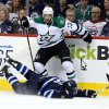 Photo - Winnipeg Jets' Blake Wheeler (26) hits the ice after trying to get past Dallas Stars' Alex Goligoski (33) during second period NHL hockey action at MTS Centre in Winnipeg, Sunday, March 16, 2014. (AP Photo/The Canadian Press, Trevor Hagan)