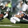 Photo - New York Jets quarterback Geno Smith (7) is sacked by New England Patriots' Chris Jones, right, during the first half of an NFL football game Sunday, Oct. 20, 2013, in East Rutherford, N.J.  (AP Photo/Kathy Willens)