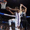 Oklahoma City's Kevin Durant, left, takes the ball past Minnesota's Ricky Rubio during Friday's game at Chesapeake Energy Arena. Photo by Nate Billings, The Oklahoman