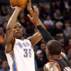 Oklahoma City\'s Kevin Durant puts up a shot over Portland\'s LaMarcus Aldridge during their NBA basketball game at the Ford Center in Oklahoma City, Okla., on Sunday, March 28, 2010. Photo by John Clanton, The Oklahoman