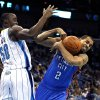 Oklahoma City Thunder\'s Thabo Sefolosha (2) loses control of the ball as he drives the lane against New Orleans Hornets\' Emeka Okafor (50) in the first half of an NBA basketball game in New Orleans, Wednesday, Jan. 11, 2012. (AP Photo/Gerald Herbert)