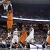 Oklahoma State\'s Brian Williams (4) scores against Texas during the second half of an NCAA college basketball game, Saturday, Feb. 9, 2013, in Austin, Texas. Oklahoma State won 72-59. (AP Photo/Eric Gay) ORG XMIT: TXEG110