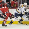 Chicago Blackhawks\' Brent Seabrook, left, and Nashville Predators\' Craig Smith (15) fight for the puck during the first period of an NHL hockey game Friday, April 19, 2013, in Chicago. (AP Photo/Jim Prisching)