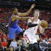 Houston\'s Omer Asik (3) goes up for a lay up as Oklahoma City\'s Thabo Sefolosha (2) defends during Game 4 in the first round of the NBA playoffs between the Oklahoma City Thunder and the Houston Rockets at the Toyota Center in Houston, Texas, Monday, April 29, 2013. Photo by Bryan Terry, The Oklahoman