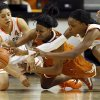From left, Oklahoma State\'s Brittney Martin (22), Texas\' Empress Davenport (1) and Oklahoma State\'s Toni Young (15) chase a loose ball during a women\'s college basketball game between Oklahoma State University (OSU) and the University of Texas at Gallagher-Iba Arena in Stillwater, Okla., Saturday, March 2, 2013. Photo by Nate Billings, The Oklahoman
