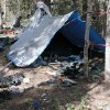 Photo - FILE - This undated file photo provided by the Iron County Sheriff's Office shows a remote camp littered with supplies and trash, believed to have been left behind by Troy James Knapp, in the southern Utah wildness near Zion National Park. Authorities say they have arrested Knapp, a survivalist suspected of burglarizing Utah cabins and evading law enforcement for years. (AP Photo/Iron County Sheriff, File)