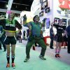"Photo -  Rodrigo Suarez, center, plays the ""Just Dance"" video game at the Nintendo booth at the Electronic Entertainment Expo on Wednesday in Los Angeles. AP Photo  <strong>Jae C. Hong -  AP </strong>"