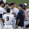 Photo - Virginia coach Brian O'Connor confers with pitcher Nathan Kirby in the third inning of one of the best-of-three games against Vanderbilt in the NCAA baseball College World Series finals in Omaha, Neb., Monday, June 23, 2014. (AP Photo/Nati Harnik)
