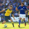 Photo - Leicester City's Leonardo Ulloa, right, and Arsenal's Aaron Ramsey during their English Premier League soccer match against at the King Power Stadium, Leicester, England, Sunday, Aug. 31, 2014. (AP Photo/Nick Potts, PA Wire)     UNITED KINGDOM OUT    -   NO SALES   -   NO ARCHIVES
