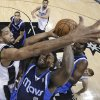 Photo - Dallas Mavericks' Jae Crowder (9) looks to the basket as San Antonio Spurs' Tim Duncan, left, defends during the first half on an NBA basketball game, Wednesday, Jan. 8, 2014, in San Antonio.  (AP Photo/Eric Gay)