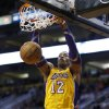 Los Angeles Lakers\' Dwight Howard dunks against the Phoenix Suns during the first half on an NBA basketball game, Wednesday, Jan. 30, 2013, in Phoenix. (AP Photo/Matt York)