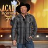 Photo - FILE - This April 6, 2014 file photo shows country singer Garth Brooks at the 49th annual Academy of Country Music Awards at the MGM Grand Garden Arena in Las Vegas. Brooks, one of the last musicians to refuse put his music on iTunes, will make his songs available digitally though his own website. The country singer made the announcement Thursday, July 10, at a press conference in Nashville, Tennessee. Brooks said in the past he had no animosity with Apple, but disagreed with its approach to selling music. (Photo by Chris Pizzello/Invision/AP, File)