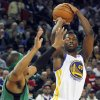 Golden State Warriors\' Harrison Barnes (40) shoots as Boston Celtics\' Paul Pierce guards during the second half of an NBA basketball game in Oakland, Calif., Saturday, Dec. 29, 2012. (AP Photo/George Nikitin)