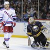 New York Rangers\' Ryane Clowe (29) and Buffalo Sabres\' Jhonas Enroth (1) react after a goal by Rick Nash (not shown) during the second period of an NHL hockey game in Buffalo, N.Y., Friday, April 19, 2013. (AP Photo/Gary Wiepert)