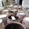 Earthquake-damaged wine barrels are lined up after being removed from Napa Barrel Care Monday, Aug. 25, 2014, in Napa, Calif. A powerful earthquake that struck the heart of California\'s wine country caught many people sound asleep, sending dressers, mirrors and pictures crashing down around them and toppling wine bottles in vineyards around the region. The magnitude-6.0 quake struck at 3:20 a.m. PDT Sunday near the city of Napa. (AP Photo/Eric Risberg)
