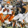 OSU\'s Ryan Simmons (52) runs from UTSA\'s Kam Jones (1) and Cody Harris (68) after intercepting the ball in the second quarter during a college football game between the University of Texas at San Antonio Roadrunners (UTSA) and the Oklahoma State University Cowboys (OSU) at the Alamodome in San Antonio, Saturday, Sept. 7, 2013. Photo by Nate Billings, The Oklahoman