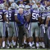Photo -   In this photo taken Saturday, Sept. 1, 2012, Kansas State coach Bill Snyder, center, talks to his team during a timeout in an NCAA college football game against Missouri State in Manhattan, Kan. Snyder desperately wanted No. 22 Kansas State to start fast in its season opener. Didn't happen. So, he figures, perhaps he'll just make sure the Wildcats finish strong. After all, that's what helped them beat Miami _ this Saturday's opponent _ with a dramatic goal line stand last year.(AP Photo/Orlin Wagner)