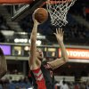 Toronto Raptors center Jona Valanciunas, right, of Lithuania, drives to the basket past Sacramento Kings center DeMarcus Cousins during the first quarter of an NBA basketball game in Sacramento, Calif., Wednesday, Dec. 5, 2012. (AP Photo/Rich Pedroncelli)