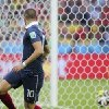 Photo - France's Karim Benzema looks back to see Honduras goalkeeper Noel Valladares bundle the ball into his net for an own goal during the group E World Cup soccer match between France and Honduras at the Estadio Beira-Rio in Porto Alegre, Brazil, Sunday, June 15, 2014. (AP Photo/David Vincent)