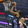 Photo - Charlotte Bobcats center Al Jefferson, center, goes to the basket against Chicago Bulls forward Taj Gibson, right, during the first half of an NBA basketball game in Chicago, Saturday, Jan. 11, 2014. (AP Photo/Kamil Krzaczynski)