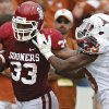OU\'s Trey Millard (33) gets past UT\'s Carrington Byndom (23) during the Red River Rivalry college football game between the University of Oklahoma (OU) and the University of Texas (UT) at the Cotton Bowl in Dallas, Saturday, Oct. 13, 2012. Photo by Chris Landsberger, The Oklahoman