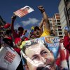 Supporters of Venezuela\'s President Hugo Chavez chant slogans at a rally in Caracas, Venezuela, Thursday, Jan. 10, 2013. Supporters of Chavez rallied outside his presidential palace in an exuberant symbolic inauguration for a leader too ill to return home for the real thing. The government organized the unusual show of support for the cancer-stricken leader on the streets outside Miraflores Palace on what was supposed to be his inauguration day. (AP Photo/Ariana Cubillos)