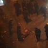 Egyptian riot police beat a man, after stripping him during clashes next to the presidential palace, Friday, Feb. 1, 2013, in Cairo. Protesters denouncing Egypt\'s Islamist president hurled stones and firebombs through the gates of his palace gates on Friday, clashing with security forces who fired tear gas and water cannons, as more than a week of political violence came to Mohammed Morsi\'s symbolic doorstep for the first time. (AP Photo/Khalil Hamra)