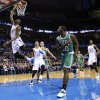 Oklahoma City\'s Kevin Durant (35) shoots a lay up as Boston\'s Brandon Bass (30) looks on during the NBA game between the Oklahoma City Thunder and the Boston Celtics at the Chesapeake Energy Arena., Sunday, Jan. 5, 2014. Photo by Sarah Phipps, The Oklahoman