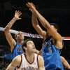 Oklahoma City\'s Nick Collison (4) tries to get the ball past the defense of Dirk Nowitzki (41) and Tyson Chandler (6) of Dallas during the NBA basketball game between the Dallas Mavericks and the Oklahoma City Thunder at the Oklahoma City Arena in Oklahoma City, Monday, Dec. 27, 2010. Photo by Nate Billings, The Oklahoman