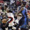 Portland Trail Blazers guard Wesley Matthews, left, races to the basket past Dallas Mavericks center Bernard James during the first quarter of an NBA basketball game in Portland, Ore., Tuesday, Jan. 29, 2013.(AP Photo/Don Ryan)