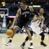 Brooklyn Nets\' Joe Johnson (7) drives past Milwaukee Bucks\' Marquis Daniels (6) during the first half of an NBA basketball game, Wednesday, Dec. 26, 2012, in Milwaukee. (AP Photo/Morry Gash)