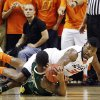 Oklahoma State guard Marcus Smart, right, reaches for the ball over South Florida\'s Anthony Collins in the first half of an NCAA college basketball game in Stillwater, Okla., Wednesday, Dec. 5, 2012. (AP Photo/Sue Ogrocki)