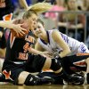 Cheyenne\'s Keisha Drouhard comes down with the ball in front do Okarche\'s Rae Grellner during the Class A girls state championship game between Okarche and Cheyenne/Reydon in the State Fair Arena at State Fair Park in Oklahoma City, Saturday, March 2, 2013. Photo by Bryan Terry, The Oklahoman